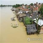 피해,인도,폭우,난민촌