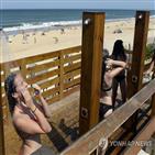 프랑스,토플리스,여성,해변,일광욕