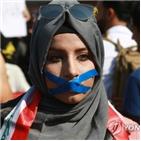 시위대,반정부,파란,시위,모자단,이라크,지시,조직,대한,친이
