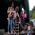 과테말라,이민자,미국,온두라스,캐러밴,국경,바이든